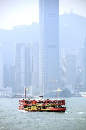 Ferry crossing between Kowloon and Hong Kong island Stock Photo