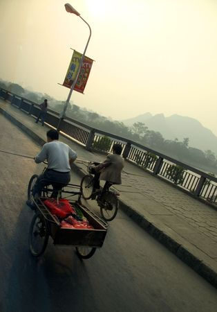 People on bikes going to work in China Stock Photo