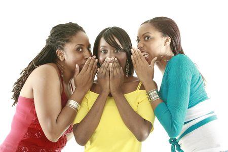 gossip: Vrienden delen roddels Stockfoto