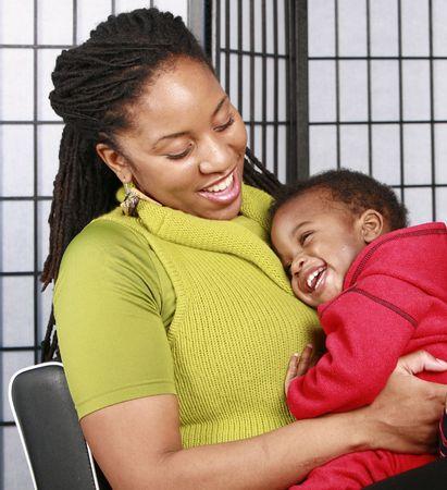 Mother hugging her happy