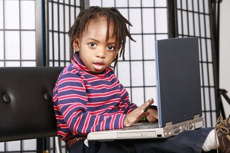 Little boy with a PC photo