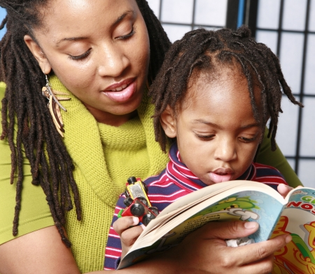 black kid: Mother reading to her son