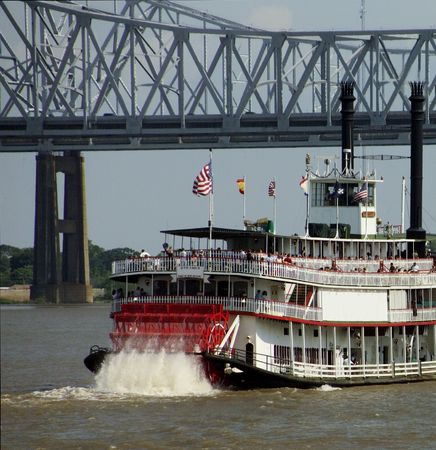 Paddle Steamer under Crescent City Connection bridge in New Orleans
