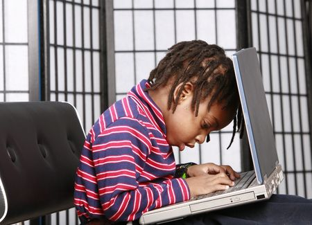 Cute kid hard at work on a PC photo