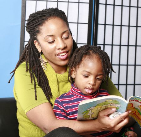 Woman reads to her little boy Stock Photo