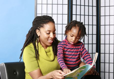 Woman reading to her little boy Stock Photo