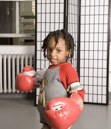 Little boy getting ready for a punch with boxing gloves Stock Photo