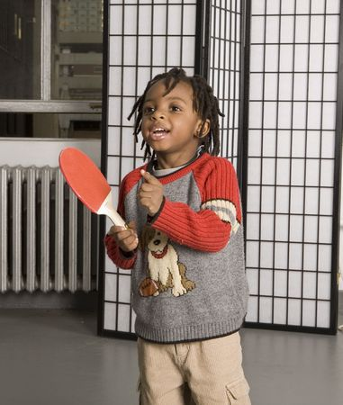 Little boy playing with a table tennis bat