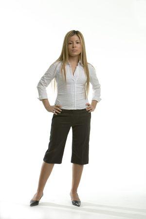 capri pants: Business woman standing