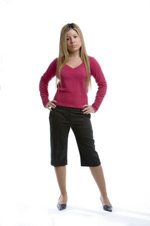 capri pants: Young woman standing
