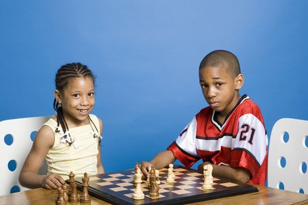 Siblings playing chess