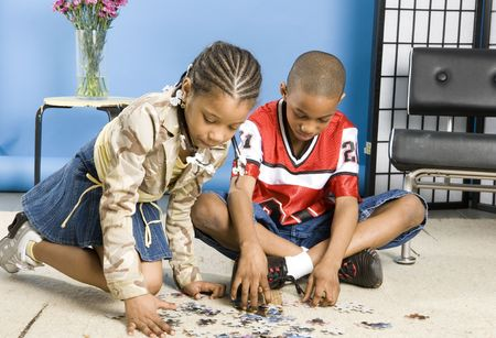 Children doing a puzzle Stock Photo