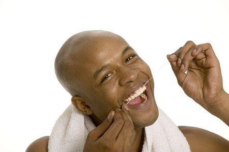 flossing: Young man flossing his teeth