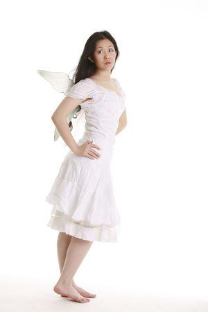 Pretty fairy in white photo