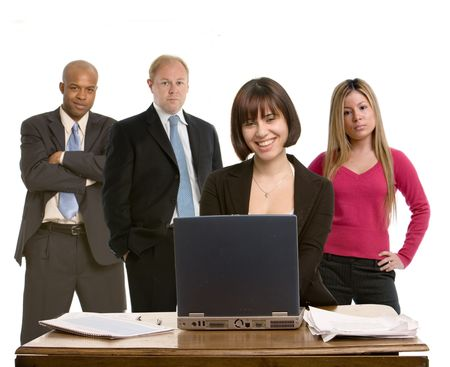succesful woman: Woman working at a computer with colleagues in background