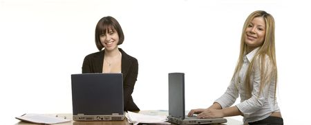 Two young business women working Stock Photo