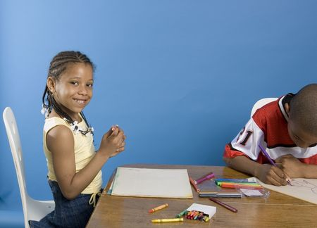 Pretty girl drawing with her brother Stock Photo - 640921