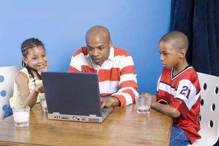 Father and his children play with PC Stock Photo