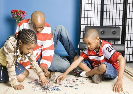 Father and children playing photo