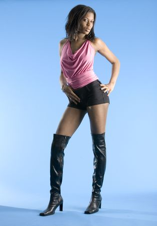 sexy boots: Leggy beauty with a hand on her hip Stock Photo