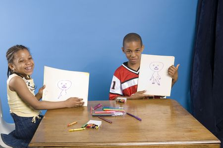 Two young artists showing their work