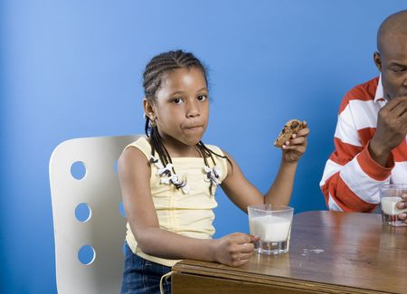 Girl with cookie and milk Stock Photo