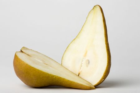 Pear cut in two halves showing juicy interior Stock Photo