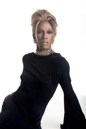 drag race: drag artist in a black dress