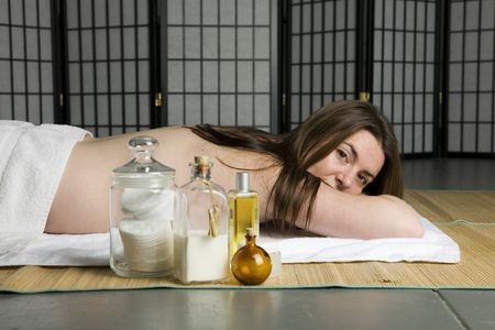 Lying on a spa mat with products in the foreground