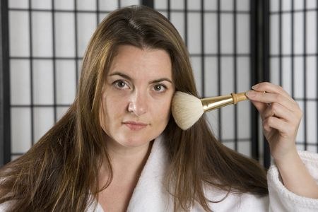 Woman with a big make up brush