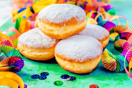 Carnival powdered sugar donuts with paper streamers