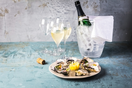 beautiful appetizer oysters and glasses champagne on Festive Table