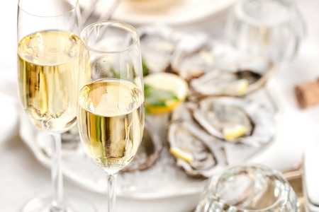 beautiful appetizer oysters two glasses wine champagne.