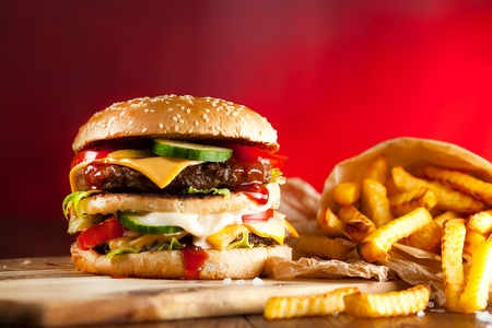 Fast food hamburger and french fries on a wooden Background