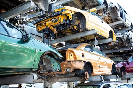 Recycling of old,used, wrecked cars. Dismantling for parts at scrap yards Stok Fotoğraf - 150557384