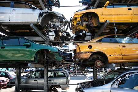 Recycling of old,used, wrecked cars. Dismantling for parts at scrap yards Stockfoto