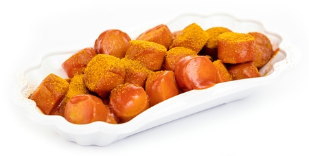 Traditional German currywurst isolated on white background. Stockfoto