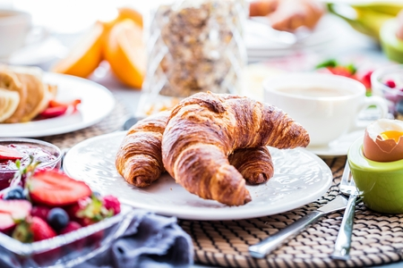 Breakfast served with coffee, orange juice and croissants