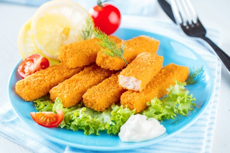 Fried Fish Sticks. Fish Fingers. Fish Sticks with lemon and sauces ready to eat. Banco de Imagens