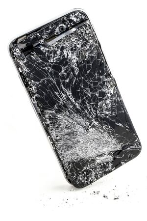 mobile phone with broken touchscreen on white background