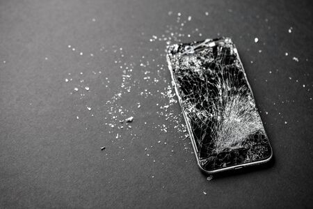mobile phone with broken touchscreen on gray background. Stok Fotoğraf