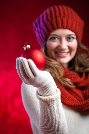 winter, people, happiness concept - woman in scarf and gloves with big snowflake