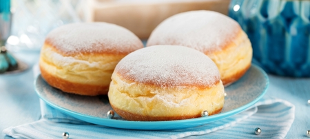 German donuts - krapfen or berliner - filled with jam for carnival