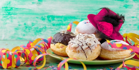 German donuts - krapfen or berliner - filled with jam for carnival