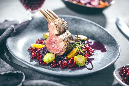 Roasted lamb or venison ribs on christmas table fetive dekoration food. Banque d'images - 112768393