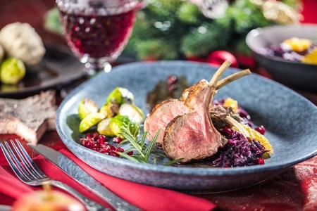 Roasted lamb or venison ribs on christmas table fetive dekoration food. Banque d'images - 112768357