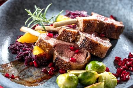 Roasted lamb or venison ribs on christmas table fetive dekoration food. Banque d'images - 112768275