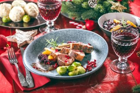 Roasted lamb or venison ribs on christmas table fetive dekoration food. Banque d'images - 113660483