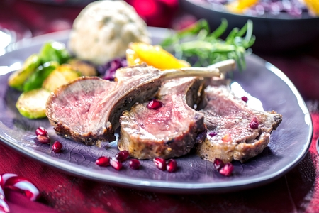Roasted lamb or venison ribs on christmas table fetive dekoration food. Banque d'images - 113660520