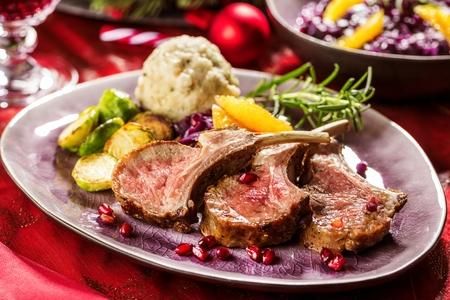 Roasted lamb or venison ribs on christmas table fetive dekoration food. Banque d'images - 113663572